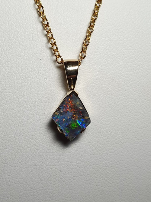 Boulder Opal Pendant set in 14K Y Gold