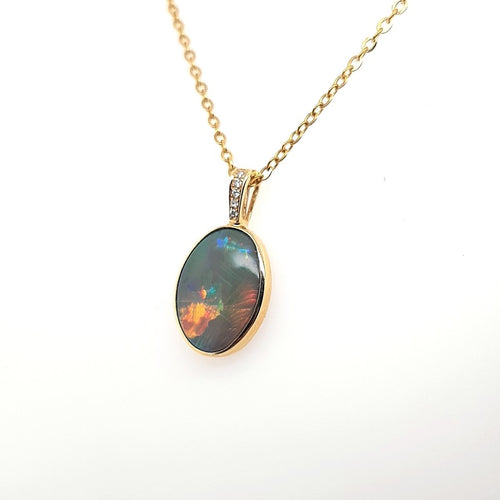 Black Opal Pendant set in 14 Karat Yellow Gold 3.30 carats with 5 x diamonds total 0.03 carats
