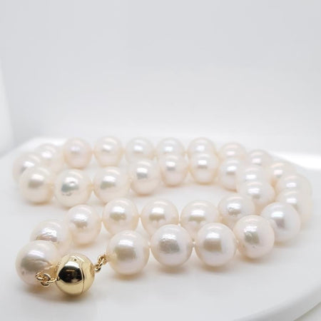 Pure Pearl Earrings set in St Silver     9mm