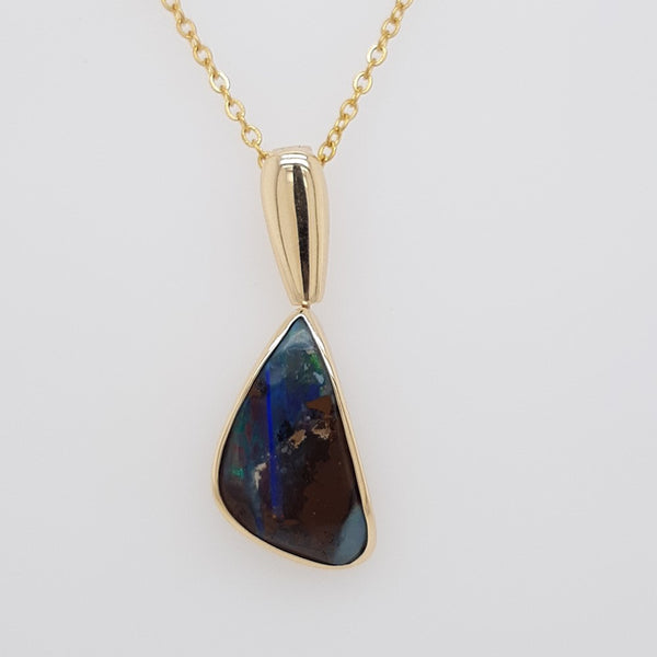 Boulder Opal 8.55ct.Pendant set in 14K Y GOLD  22x12mm