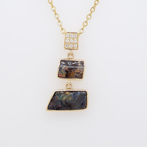 Boulder Opal 3.9ct Pendant set in 14K Y GOLD  with 9 Di total 0.06ct