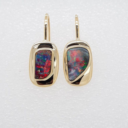 Black Opal 0.8ct 7x5mm set in 10K Yellow Gold Earrings
