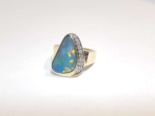 Black Opal Ring set in 14K Yellow Gold   10x Diamond 0.132Ct