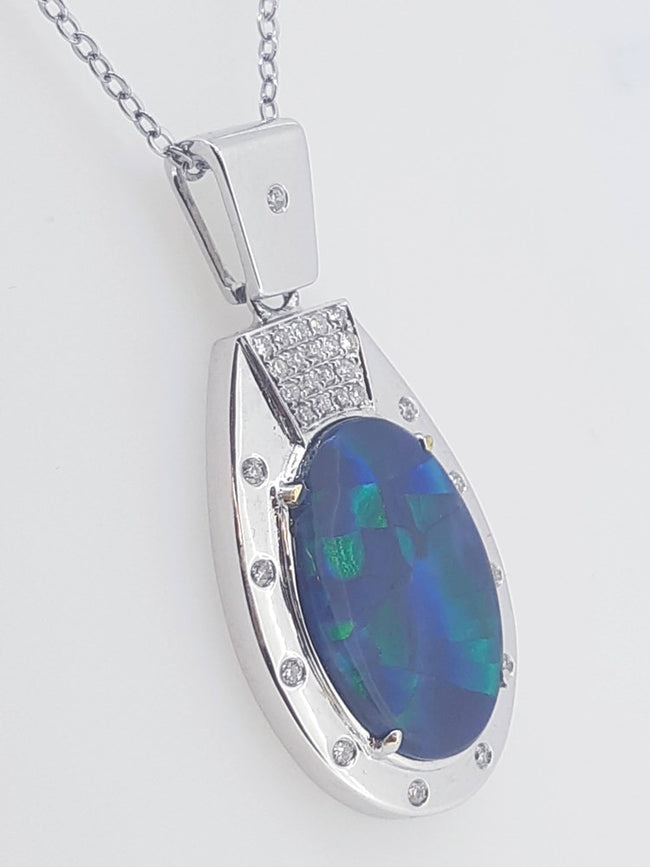Black Opal Pendant set in 18 Karat White Gold 9.30 carats with 22 x diamond total 0.33 carats