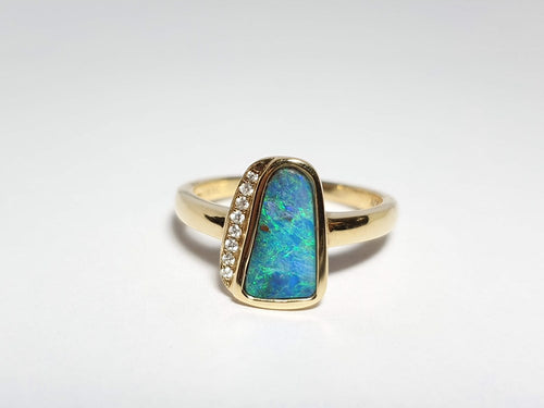 Boulder Opal Ring set in 14 Karat Yellow Gold with 8 x Diamonds total weight 0.036 Carats