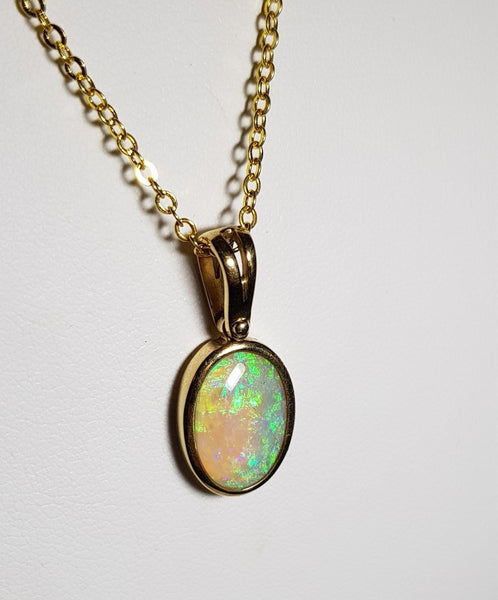 White Opal Pendant set in 9K Yellow Gold
