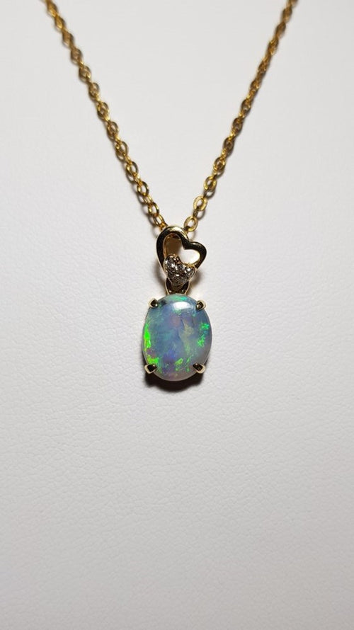 Black Opal Pendant set in 14K Yellow Gold 1.05Ct  1x Diamond 0.031Ct