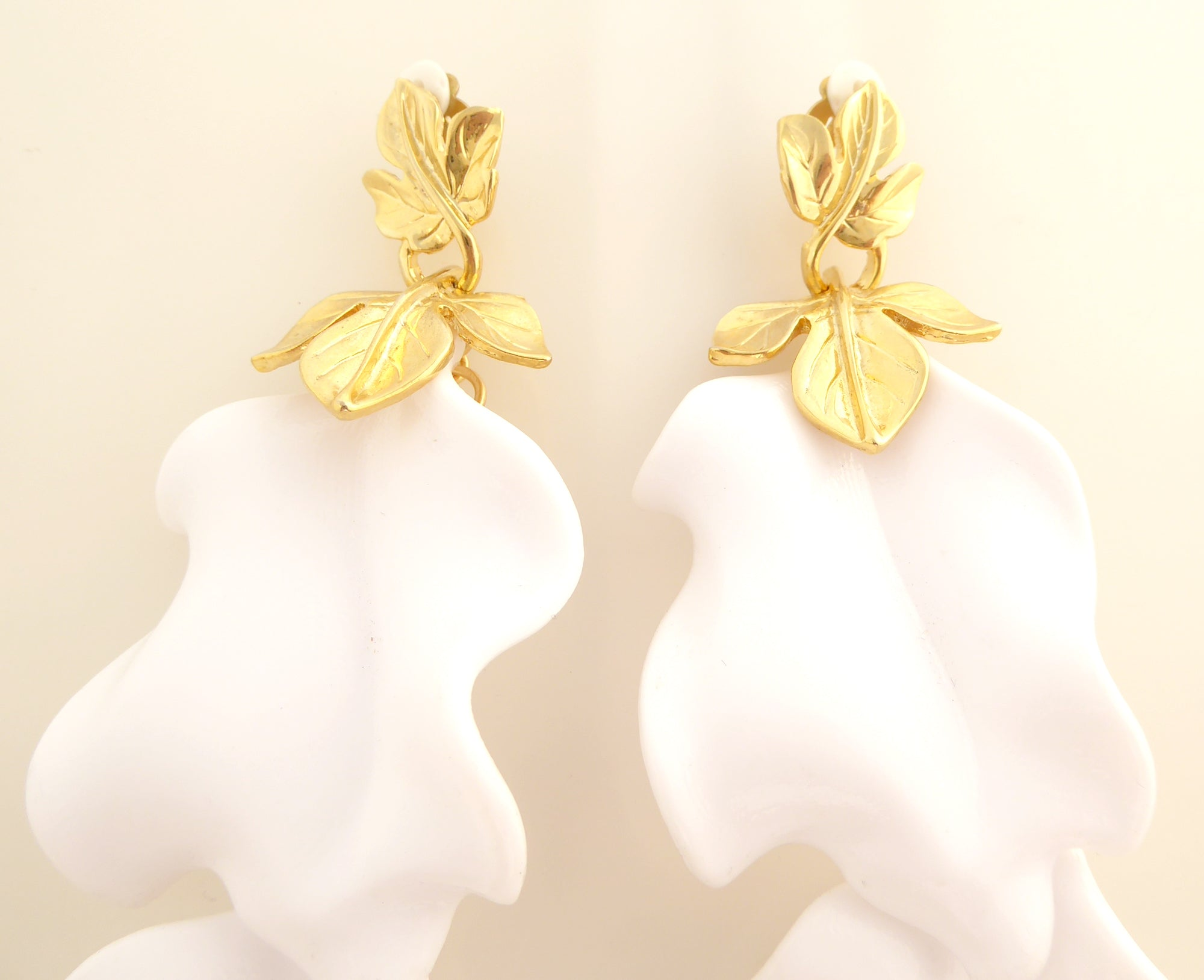White and gold leaf earrings