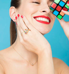 Childs Play jewellery collection featuring the wedge trivial pursuit gold ring
