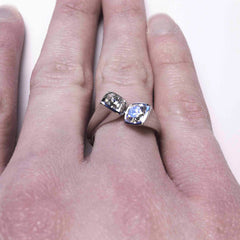 The toi et moi diamond and platinum ring as seen on a finger