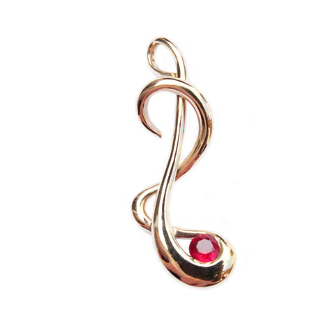 The finished pendant of redesign clients old gold into flowing ruby pendant