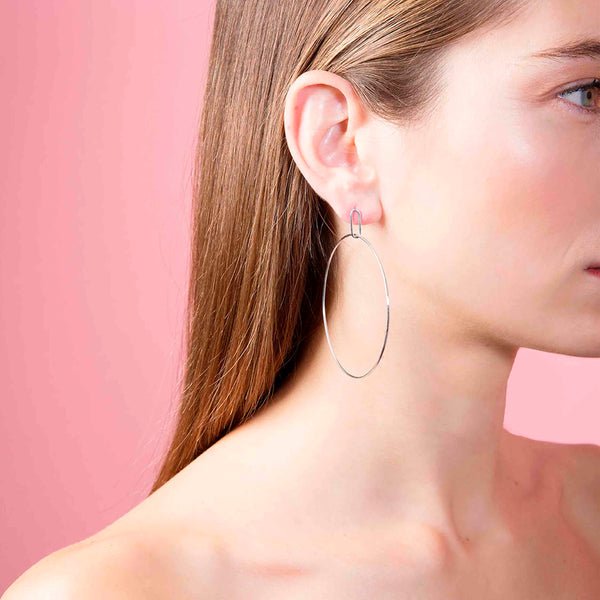 Origin 31 A modern version of hoop earrings as worn on a model, a staple for your ethical jewellery collection