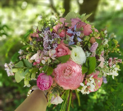 Bouquet of pink ranunculus and roses cut flowers flowers from the farm