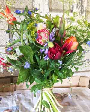Standing pretty : Hand-tied bouquet of fragrant and double tulips with bluebells, forget-me-nots, green alkanet, and cow parsley