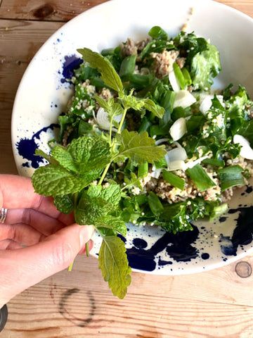 lemon balm and mint from the garden pots added to kale and couscous dish