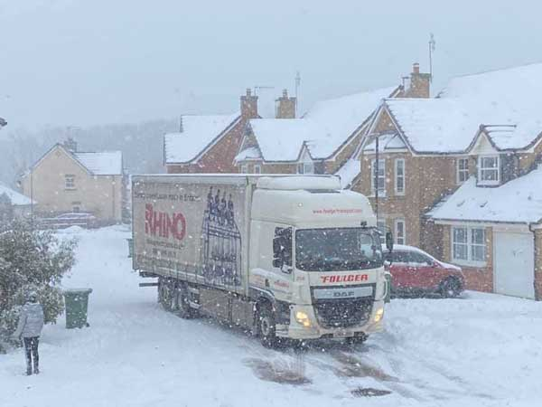 Rhino lorry delivering on a snowy day