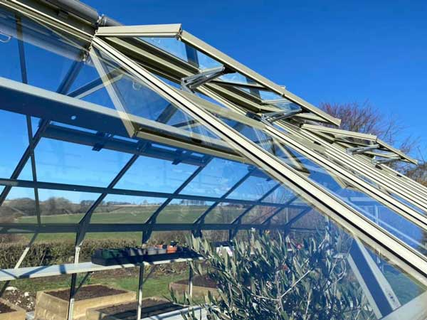 Rhino autovents opening on a sunny day in March with blue skies overhead.