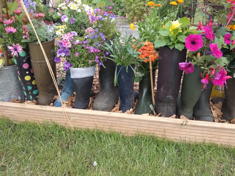 Wellies making fantastic flowerpots at this show garden, alongside our Rhino Greenhouses at the Royal Norfolk Show.