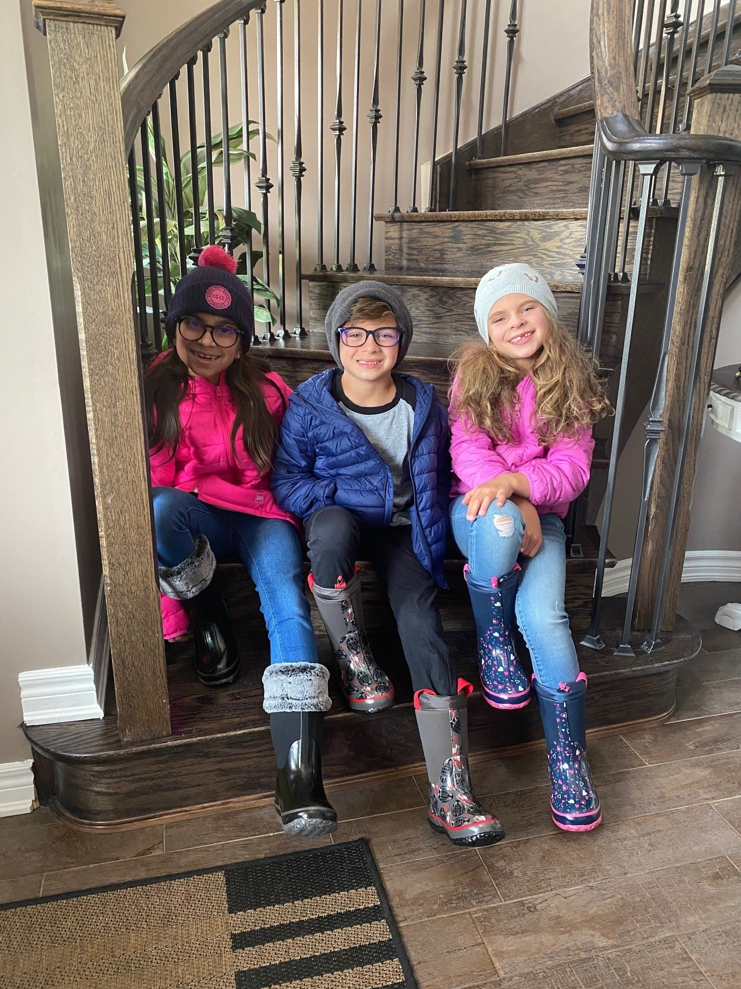 Abigail, Adrian and Madeline ready to head outside in their Neoprene's!
