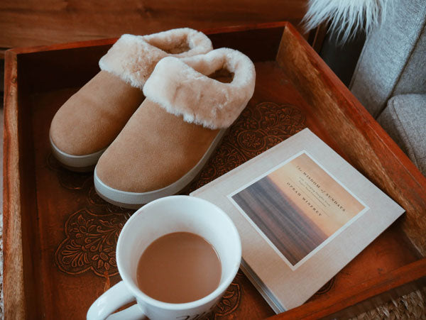 Service tray with coffee, book and Cougar Prony Shearling Mule in Tan