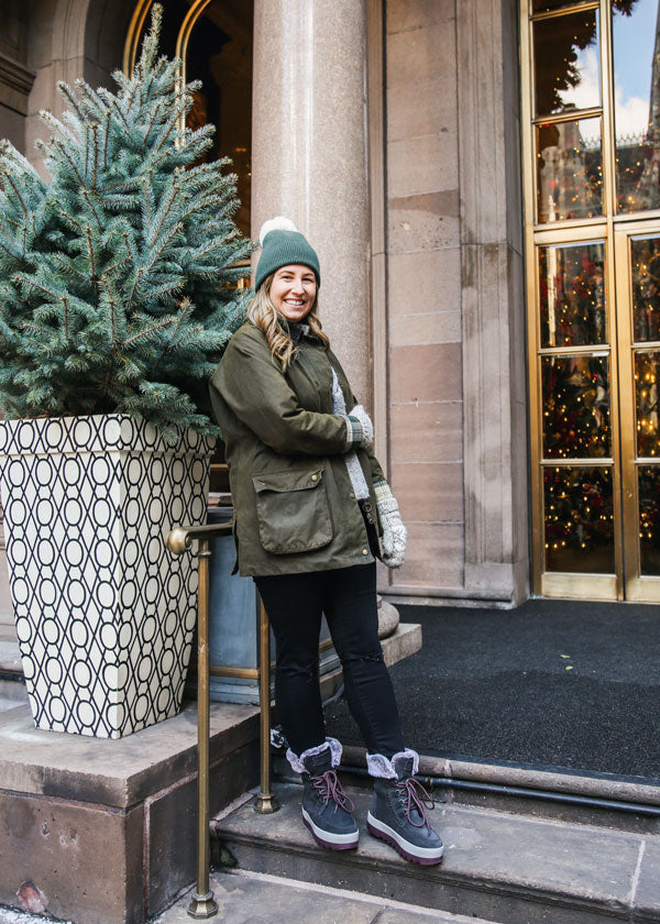 Caroline St Francis standing outside in New York and wearing Cougar Vanetta Suede Mid Boot