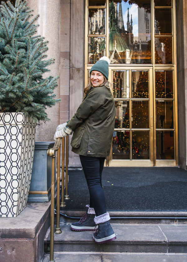 Caroline St Francis standing outside in New York and looking back wearing Cougar Vanetta Suede Mid Boot
