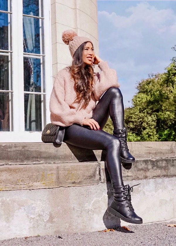 Influencer sitting outside sweater and hat, with leather leggings and Cougar Wahoo Nylon Winter Boot with PrimaLoft® in Black