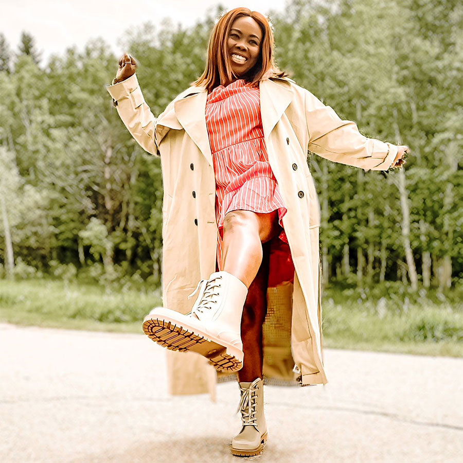 Influencer dancing with Cougar Madrid Rain Boots in Dove