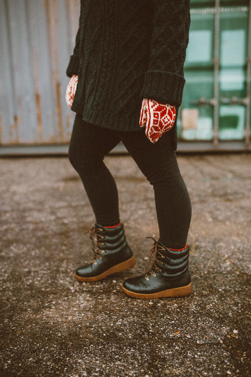 Influencer lower body walking outside in black jeans, red and white mits wearing Cougar Original Pillow Boot in Black