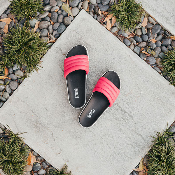 Overhead view of Cougar Leather Prato Leather Sandal in Rose on concrete tile