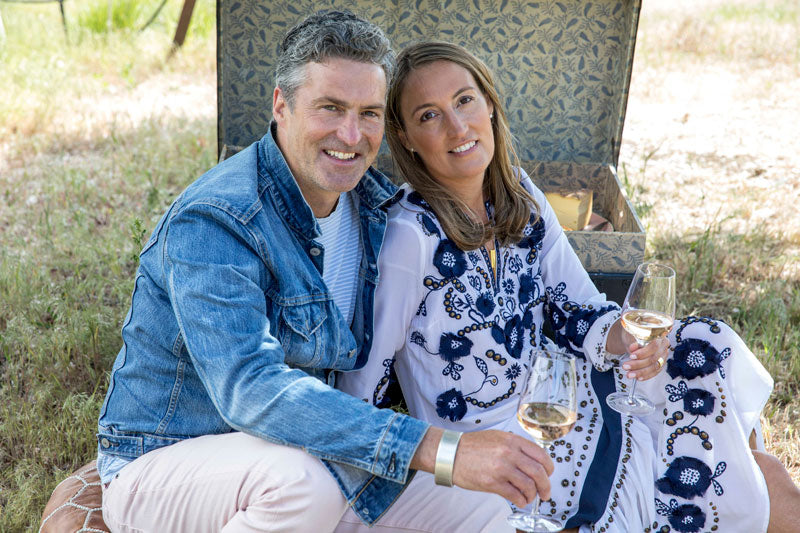 Sarah Bancroft with Husband having a picnic with wine.