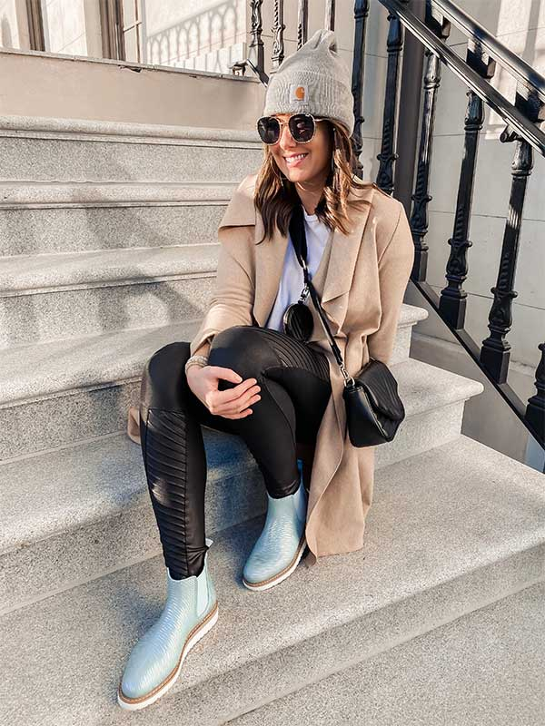 Influencer in tan jacket and sitting on townhouse stoop wearing Cougar Kensington Rainshine Chelsea Boot in Mica
