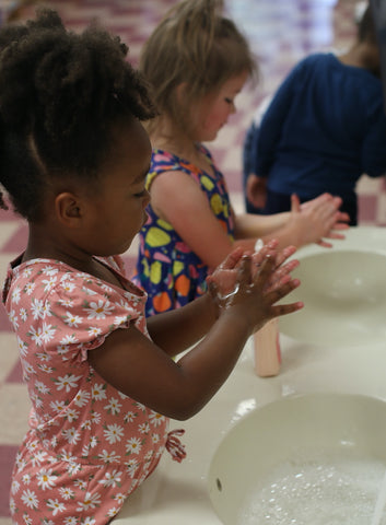 Students at Bright Ideas Enrichment Center washing hands