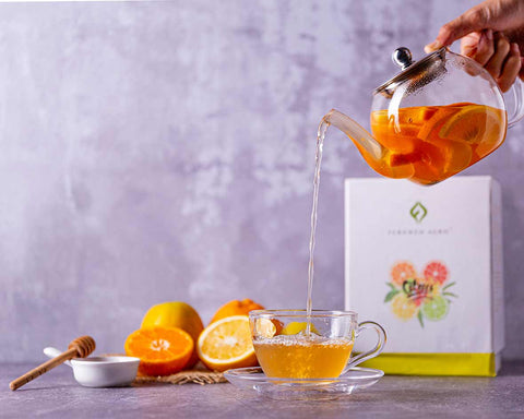 A handsome assorted collection of citrus teas in loose leaf & tea bags by Fernweh Agro