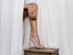 A woman is exfoliating her legs