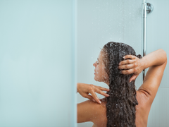 A young woman is taking a shower