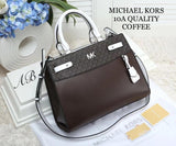 MICHAEL KORS SLING BAG.