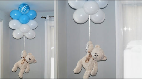 teddy bear hanging with balloons decoration