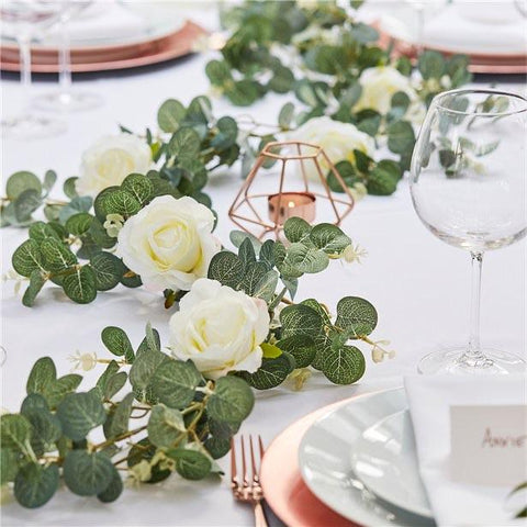 green artificial foliage with white roses