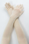Delp Stockings Extra Long Ladies Silk Gloves. Cream color view on model.