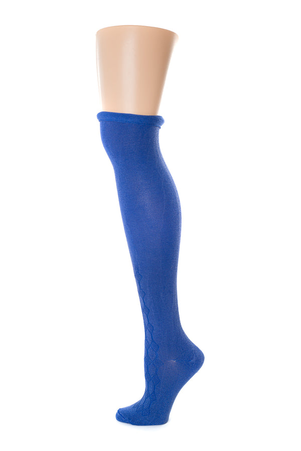 Delp Stockings, Roll Garters on Royal Blue Openwork stocking. Side view, showing pink garter being rolled into stocking just above the knee.