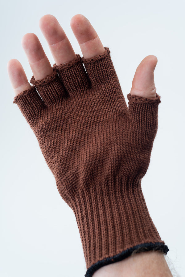 Delp Stockings, Wool Fingerless Gloves. Brown color on model, palm side view.