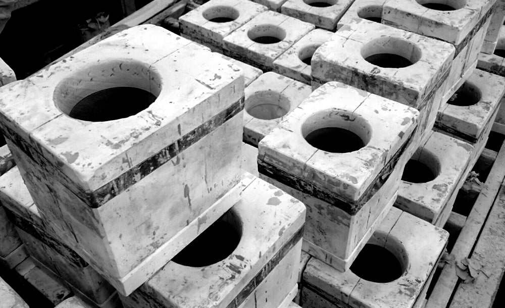 Plaster slip casting moulds held together with car inner tubes