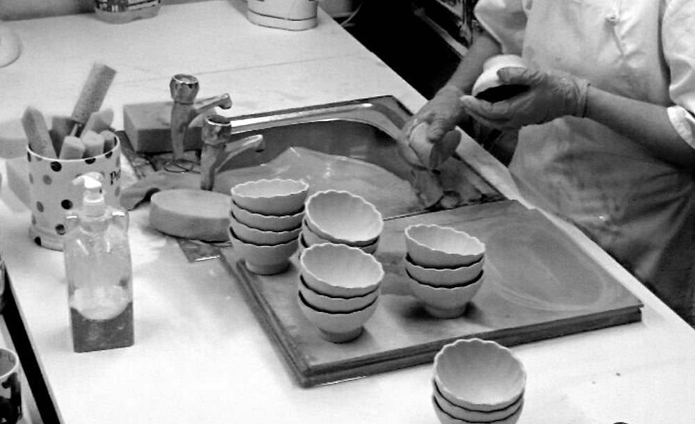 Ceramic items being Fettled and Sponged before firing in the kiln