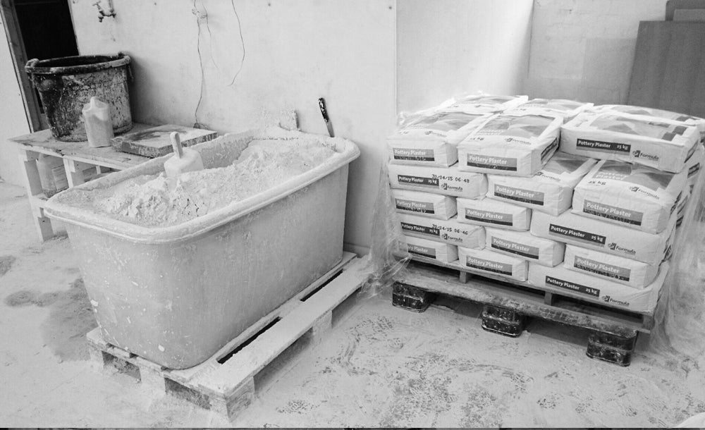 Mixing the plaster for the mug moulds