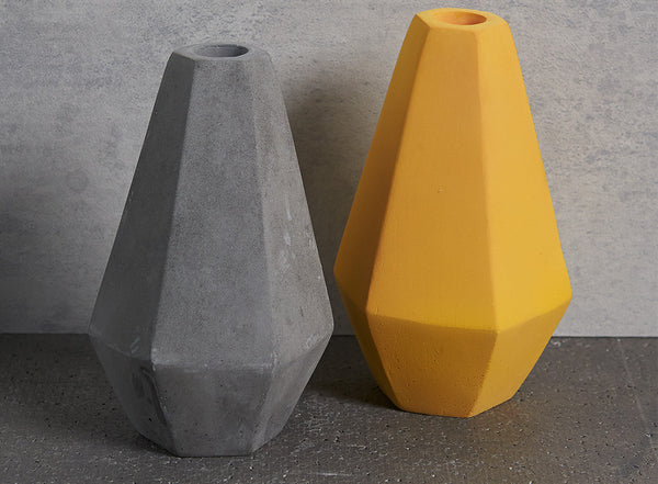 Geometric Concrete Candle Holders in grey and curry yellow by Korridor Design