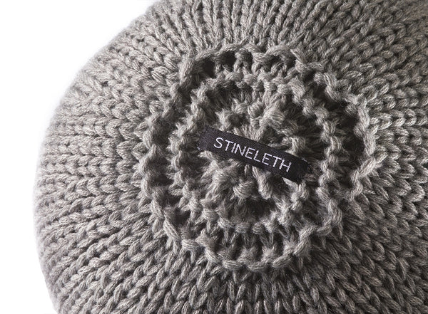 Round Knitted Ball Cushion in grey by Stine Leth for Korridor Design