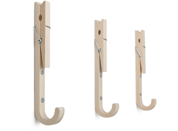 Contemporary ply wood coat hooks with upturned clothes pegs by THABTO