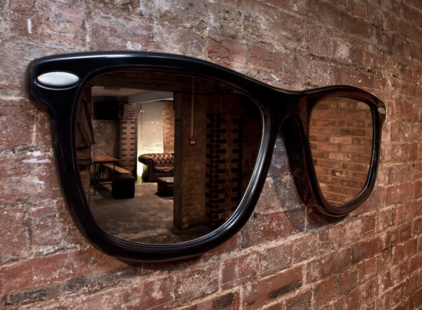 Looking Good sunglasses mirror mounted to a brick wall by THABTO