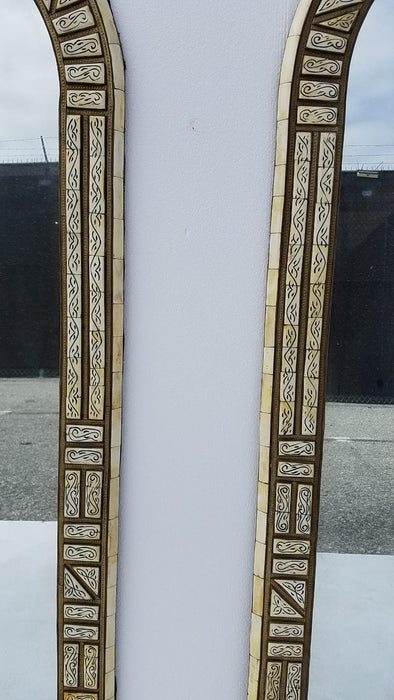 A pair of vintage white bone mirrors